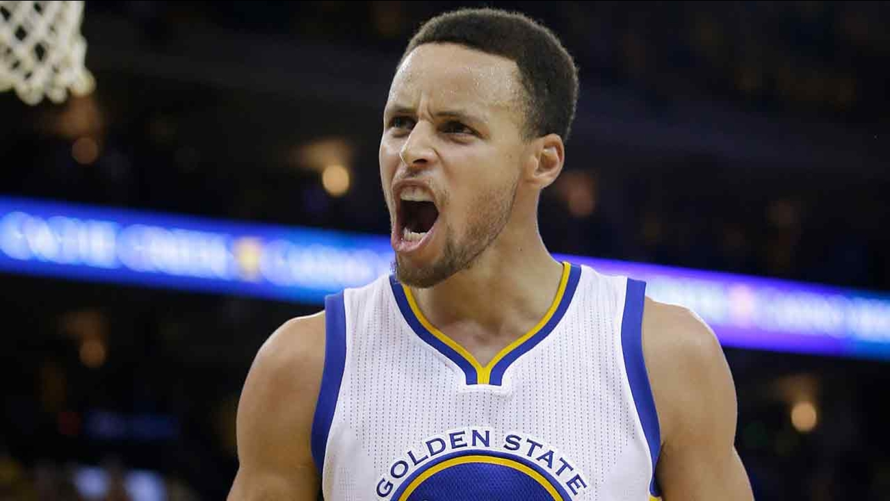 Golden State Warriors guard Stephen Curry (30) reacts after Shaun Livingston scored against the Oklahoma City Thunder Monday, May 30, 2016.