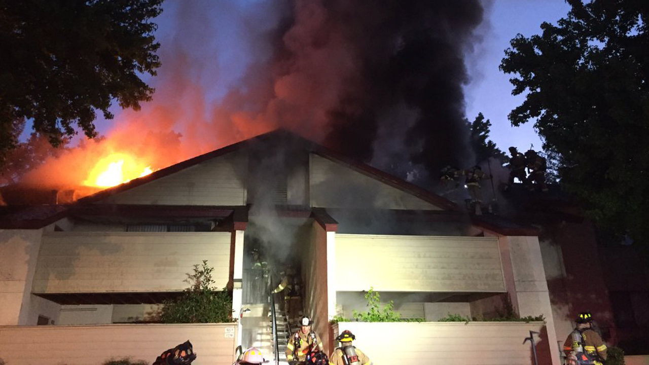 Firefighters battle two-alarm fire at apartment complex in Martinez, California, Tuesday, May 31, 2016.