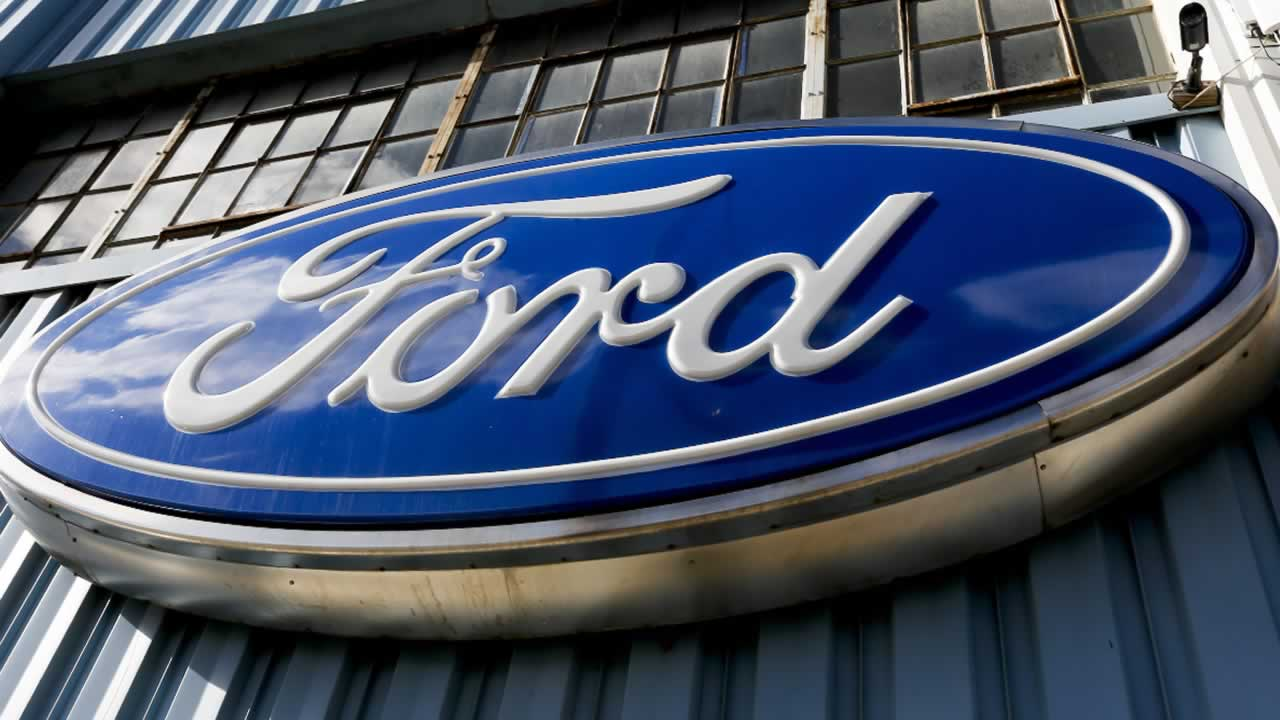 This Thursday, Nov. 19, 2015, photo, shows a Ford sign above the entrance to Butler County Ford in Butler, Pa. Ford reports financial results Thursday, April 28, 2016.