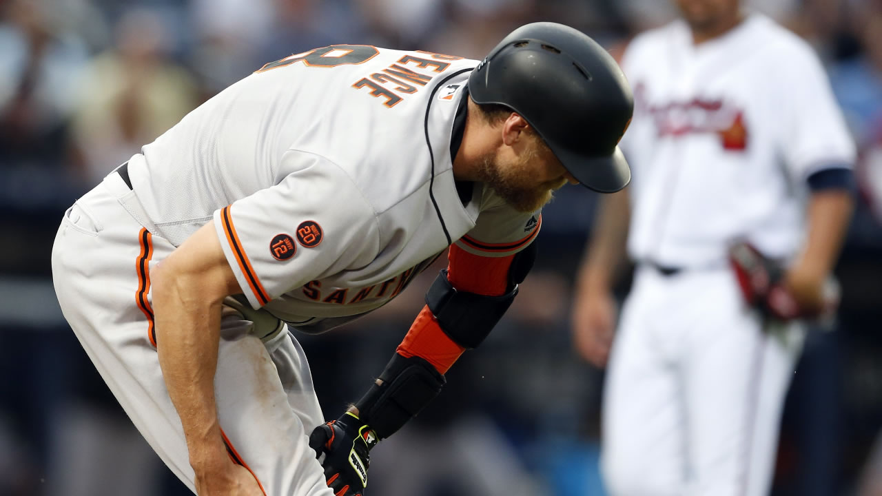 San Francisco Giants' Hunter Pence pulls up and grabs his leg during the fourth inning of a baseball game against the Atlanta Braves, Wednesday, June 1, 2016, in Atlanta.