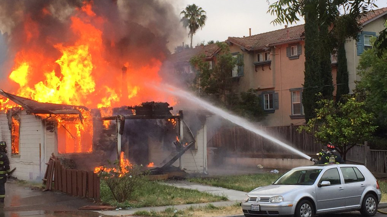 Fire at house where police say suspect in officer-involved shooting is barricaded, Fremont, California, Thursday, June 2, 2016.