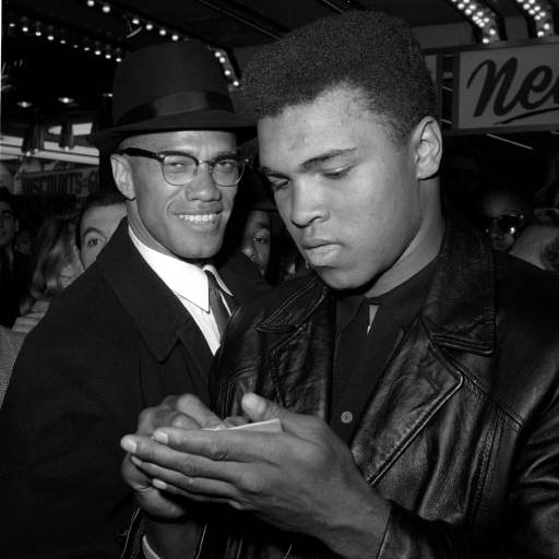 <div class='meta'><div class='origin-logo' data-origin='none'></div><span class='caption-text' data-credit='AP'>World Heavyweight Boxing Champion, Muhammad Ali, right, is shown with Black Muslim Leader, Malcolm X.</span></div>