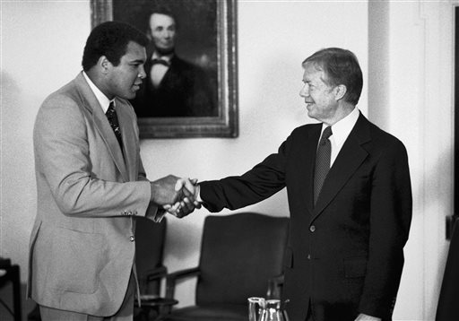 <div class='meta'><div class='origin-logo' data-origin='none'></div><span class='caption-text' data-credit='AP Photo/Jim Wilson'>In this Monday, Feb. 11, 1980 file photo, retired heavyweight boxer Muhammad Ali, left, shakes hands with President Jimmy Carter.</span></div>