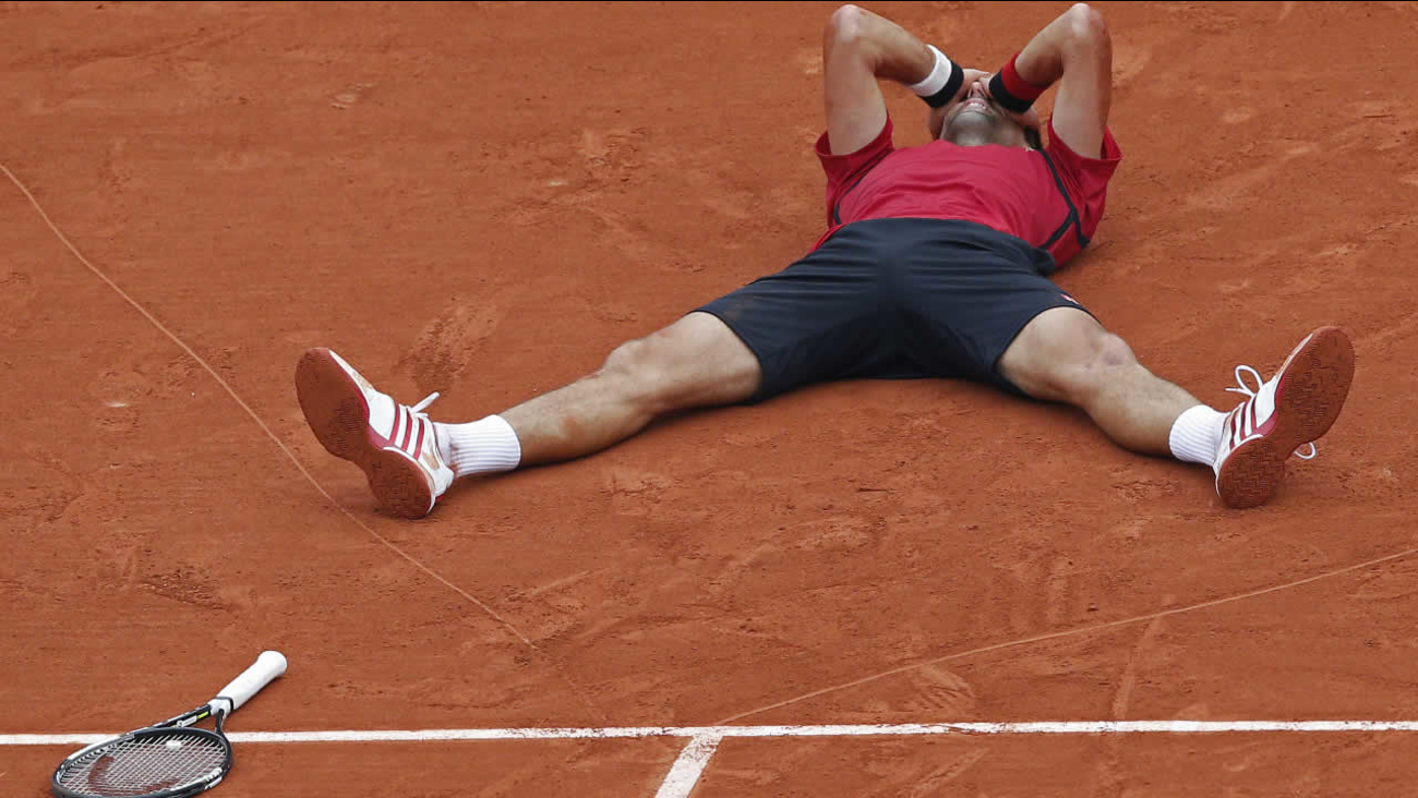 Serbia's Novak Djokovic celebrates winning the final of the French Open tennis tournament against Britain's Andy Murray at the Roland Garros stadium in Paris, France, Sunday, June 5, 2016.
