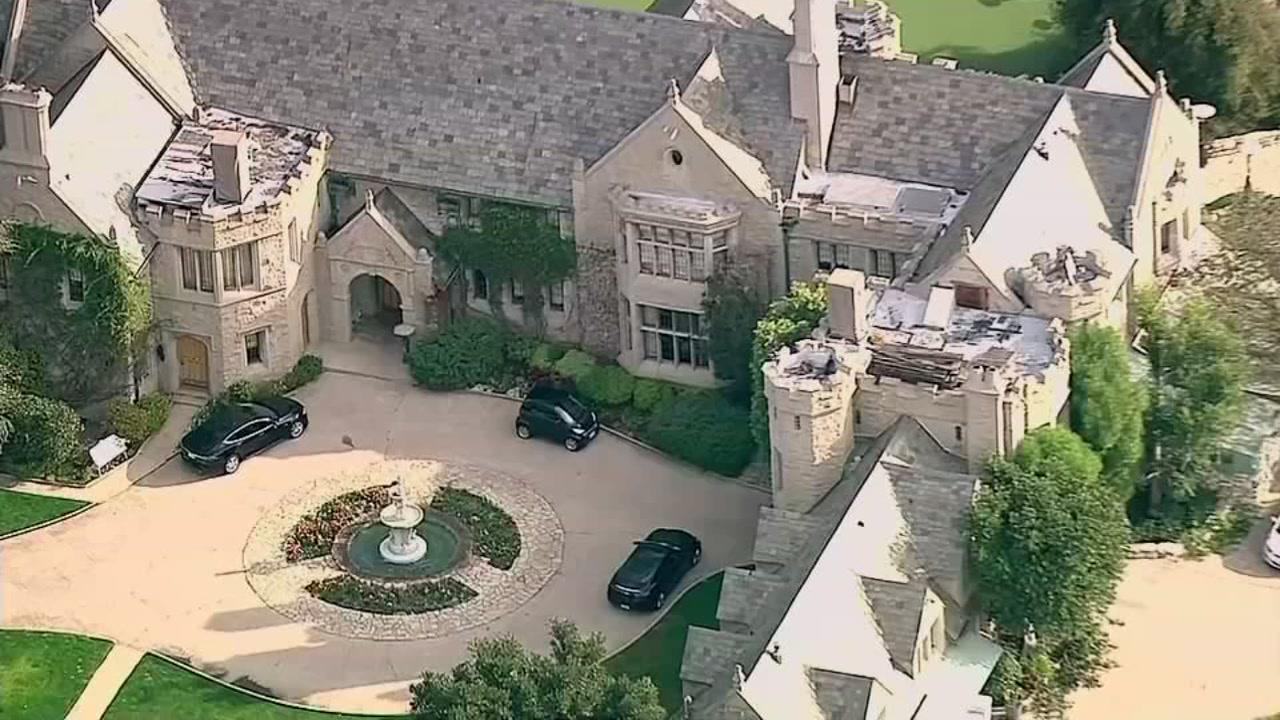 Man buying Playboy Mansion