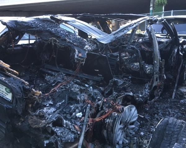 <div class='meta'><div class='origin-logo' data-origin='none'></div><span class='caption-text' data-credit=''>Range Rovers in Bucktown damaged by fire.</span></div>