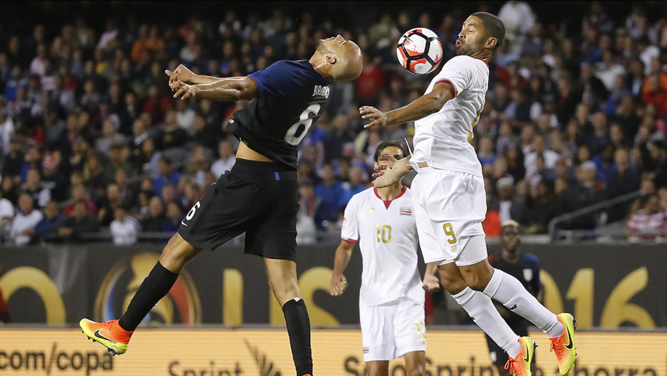 United States' John Brooks and Costa Rica's Alvaro Saborio battle during a Copa America Centenario soccer match in Chicago, June 7, 2016. (AP Photo/Charles Rex Arbogast)