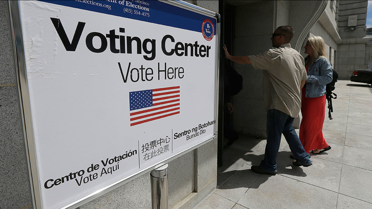 Voters enter a polling place Tuesday, June 7, 2016.