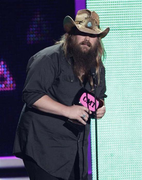 "<div class=""meta image-caption""><div class=""origin-logo origin-image none""><span>none</span></div><span class=""caption-text"">Chris Stapleton accepts the award for breakthrough video of the year for ""Fire Away"" at the CMT Music Awards at the Bridgestone Arena on June 8, 2016, in Nashville, Tenn. (Wade Payne/Invision/AP)</span></div>"