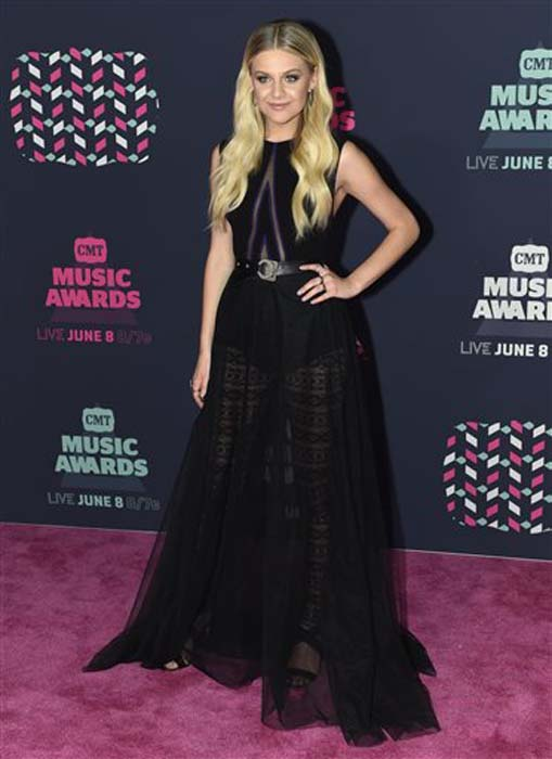 "<div class=""meta image-caption""><div class=""origin-logo origin-image none""><span>none</span></div><span class=""caption-text"">Kelsea Ballerini arrives at the CMT Music Awards at the Bridgestone Arena on Wednesday, June 8, 2016, in Nashville, Tenn. (Sanford Myers/Invision/AP)</span></div>"