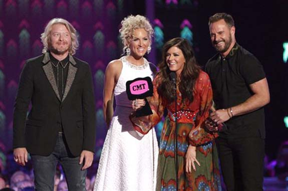 "<div class=""meta image-caption""><div class=""origin-logo origin-image none""><span>none</span></div><span class=""caption-text"">Little Big Town, from left, Phillip Sweet, Kimberly Roads Schlapman, Karen Fairchild and Jimi Westbrook accept the award for group/duo video of the year for Girl Crush."" (Wade Payne/Invision/AP)</span></div>"