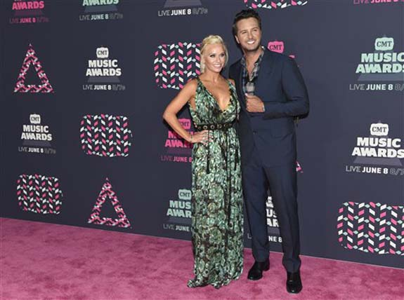 "<div class=""meta image-caption""><div class=""origin-logo origin-image none""><span>none</span></div><span class=""caption-text"">Caroline Boyer, left, and Luke Bryan arrive at the CMT Music Awards at the Bridgestone Arena on Wednesday, June 8, 2016, in Nashville, Tenn. (Sanford Myers/Invision/AP)</span></div>"