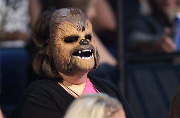 "<div class=""meta image-caption""><div class=""origin-logo origin-image none""><span>none</span></div><span class=""caption-text"">Candace Payne, also known as ""Chewbacca Mom, appears in the audience wearing her Chewbacca mask at the CMT Music Awards at the Bridgestone Arena on June 8 in Nashville, Tenn. (Wade Payne/Invision/AP)</span></div>"