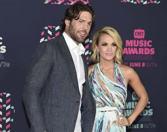 "<div class=""meta image-caption""><div class=""origin-logo origin-image none""><span>none</span></div><span class=""caption-text"">Mike Fisher, left, and Carrie Underwood arrive at the CMT Music Awards at the Bridgestone Arena on Wednesday, June 8, 2016, in Nashville, Tenn. (Sanford Myers/Invision/AP)</span></div>"