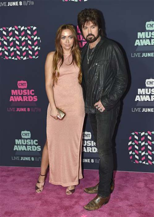 "<div class=""meta image-caption""><div class=""origin-logo origin-image none""><span>none</span></div><span class=""caption-text"">Brandi Glenn Cyrus, left, and Billy Ray Cyrus arrive at the CMT Music Awards at the Bridgestone Arena on Wednesday, June 8, 2016, in Nashville, Tenn. (Sanford Myers/Invision/AP)</span></div>"