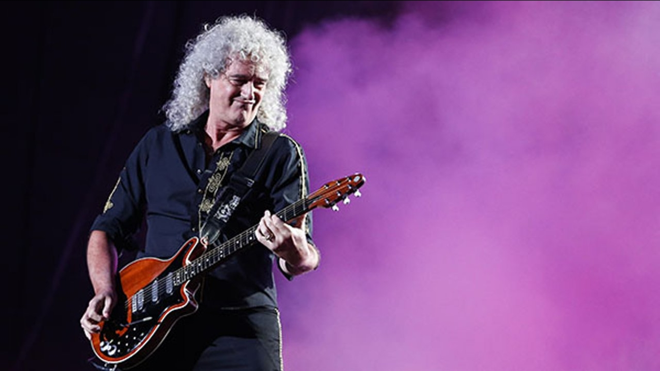 Brian May of the Queen + Adam Lambert performs at the Rock in Rio music festival in Rio de Janeiro, Brazil, early Saturday, Sept. 19, 2015.