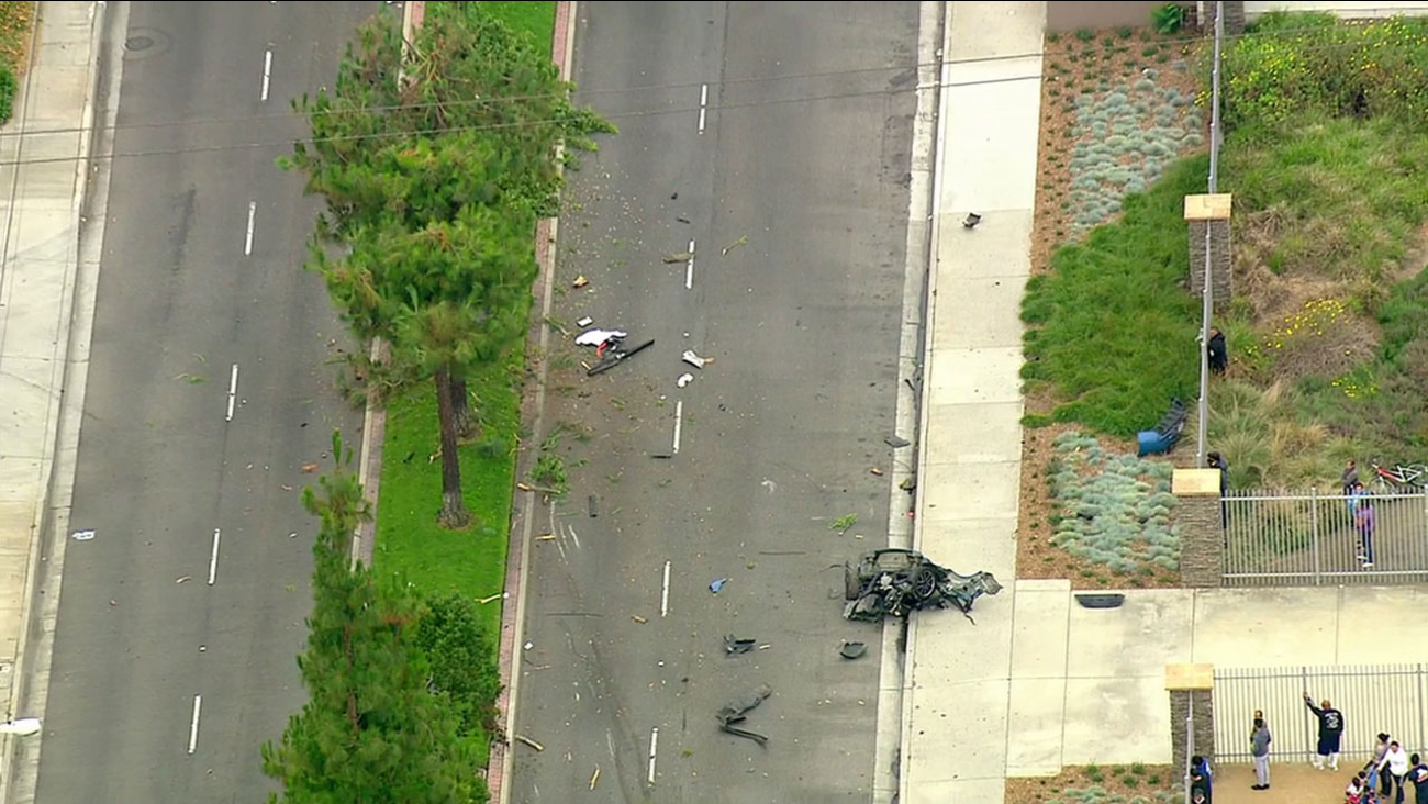 The wreckage of a single-car crash that left one passenger dead was strewn across Somerset Boulevard in Paramount on Thursday, June 9, 2016.