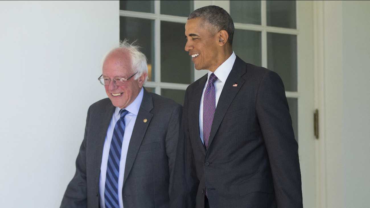 President Barack Obama walks with Democratic presidential candidate Sen. Bernie Sanders, I-Vt., down the Colonnade of the White House in Washington, Thursday, June 9, 2016.