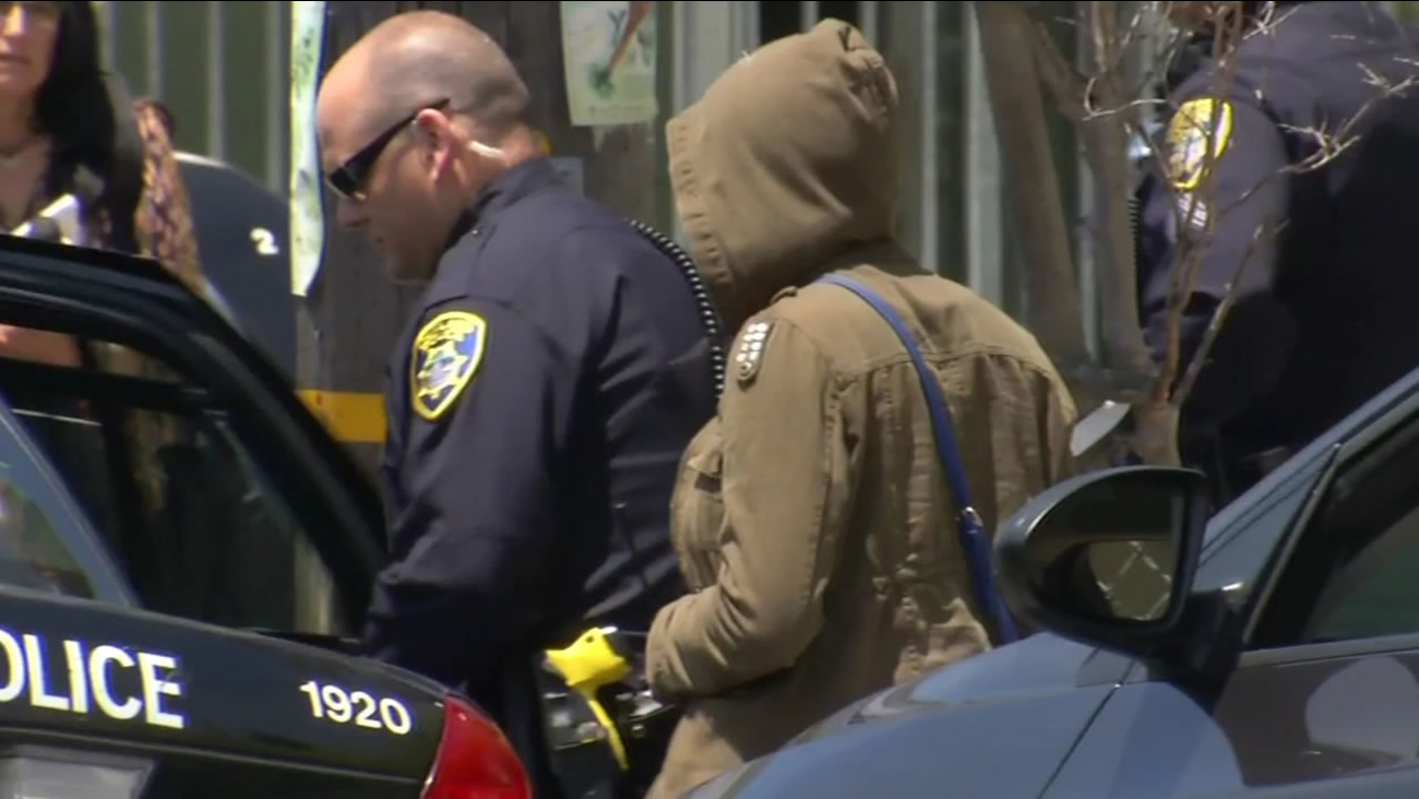 This image shows police escorting an Oakland teenager back to her family after she wad kidnapped on Wednesday, June 8, 2016.