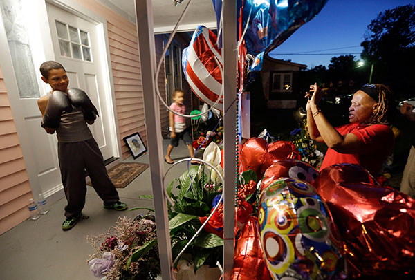 <div class='meta'><div class='origin-logo' data-origin='none'></div><span class='caption-text' data-credit='Mark Humphrey/AP Photo'>Elaine Douglas, right, photographs her grandson, Malachi Chism, 10, on the porch of Muhammad Ali's boyhood home in Louisville on Thursday, June 9, 2016.</span></div>