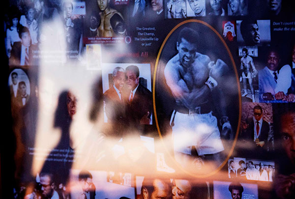 "<div class=""meta image-caption""><div class=""origin-logo origin-image none""><span>none</span></div><span class=""caption-text"">A collage of Muhammad Ali images is displayed as a visitor is reflected in the glass while looking over a makeshift memorial to Ali at the Muhammad Ali Center Thursday, June 9. (David Goldman/AP Photo)</span></div>"