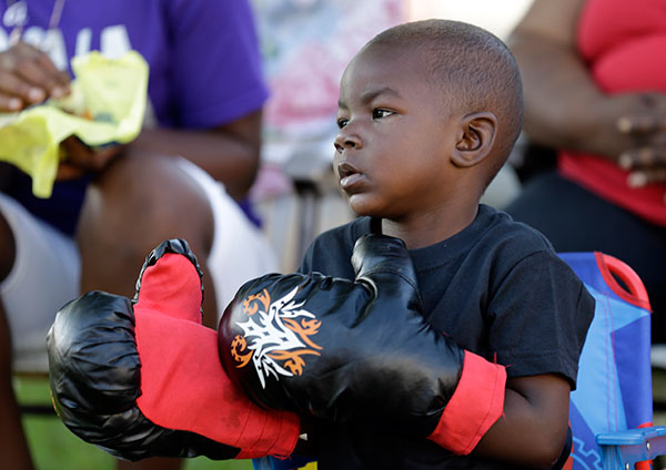 <div class='meta'><div class='origin-logo' data-origin='none'></div><span class='caption-text' data-credit='Michael Conroy/AP Photo'>Tymetrius Steward, 3, wears boxing gloves to honor Muhammad Ali as he awaits his funeral procession to make its way down Muhammad Ali Boulevard in Louisville, Ky. Friday, June 10.</span></div>