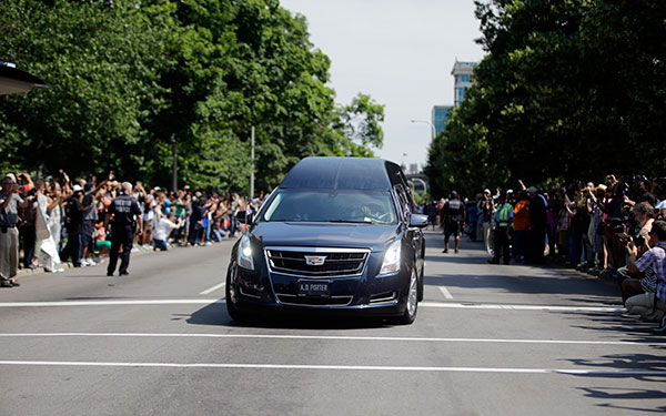 <div class='meta'><div class='origin-logo' data-origin='none'></div><span class='caption-text' data-credit='Darron Cummings/AP Photo'>Crowds line the route of the procession led by the hearse carrying the body of Muhammad Ali, Friday, June 10, 2016.</span></div>