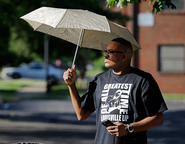 <div class='meta'><div class='origin-logo' data-origin='none'></div><span class='caption-text' data-credit='Darron Cummings/AP Photo'>Dale James waits for the procession to pass with the hearse carrying the body of Muhammad Ali, Friday, June 10, 2016, in Louisville, Ky.</span></div>