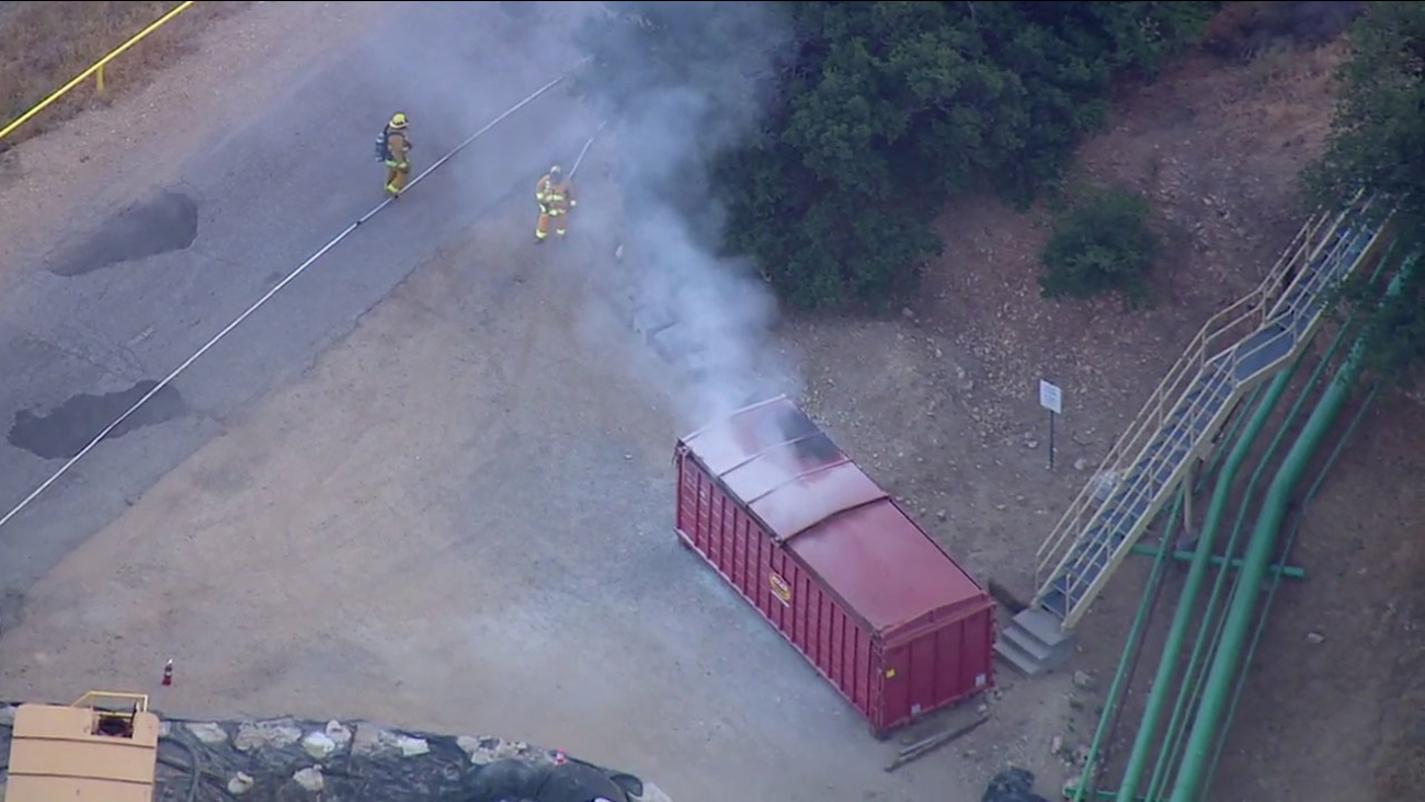 Firefighters extinguish a fire that broke out in a storage container at the Aliso Canyon gas storage facility in Porter Ranch on Thursday, June 9, 2016.