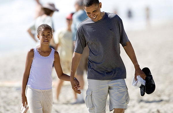 <div class='meta'><div class='origin-logo' data-origin='none'></div><span class='caption-text' data-credit='AP'>Democratic presidential candidate Sen. Barack Obama, D-Ill. walks down the beach with his daughter Malia, 10, during his vacation to Hawaii, Aug. 12, 2008.  (AP Photo/Marco Garcia)</span></div>