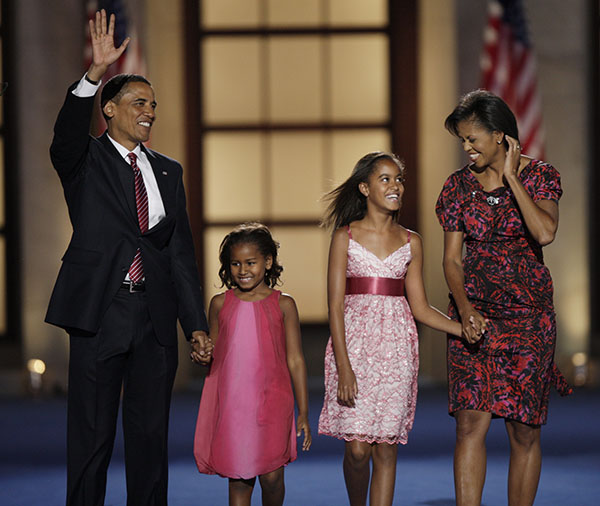 <div class='meta'><div class='origin-logo' data-origin='none'></div><span class='caption-text' data-credit='AP'>Presidential nominee Obama, his wife, and daughters Malia, 10, second from right, and Sasha, 7, wave after his acceptance speech at the Democratic National Convention in 2008</span></div>
