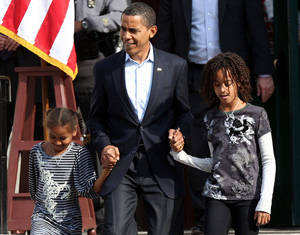 <div class='meta'><div class='origin-logo' data-origin='none'></div><span class='caption-text' data-credit='ASSOCIATED PRESS'>Presidential candidate Obama walks with his daughters Sasha, 7, left, and Malia, 10, right, before a rally Sunday, Nov, 2, 2008 (AP Photo/Terry Gilliam)</span></div>