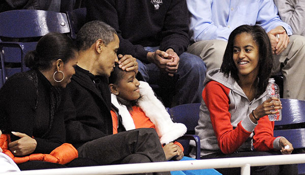 <div class='meta'><div class='origin-logo' data-origin='none'></div><span class='caption-text' data-credit='AP'>Nov. 27, 2010, President Obama kisses Sasha on the head while Malia, right, and Michelle Obama look during an NCAA college basketball game (AP Photo/Cliff Owen, File)</span></div>