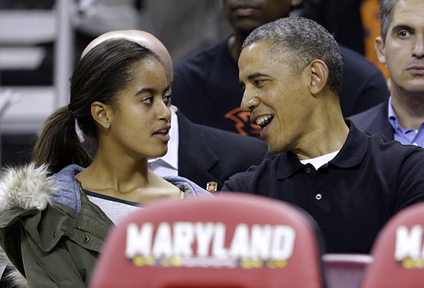 <div class='meta'><div class='origin-logo' data-origin='none'></div><span class='caption-text' data-credit='AP'>Nov. 17, 2013, President Barack Obama as he chats with daughter Malia before an NCAA college basketball game (AP Photo/Patrick Semansky, File)</span></div>