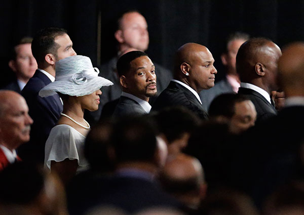 <div class='meta'><div class='origin-logo' data-origin='none'></div><span class='caption-text' data-credit='David Goldman/AP Photo'>Actor Will Smith waits for the Ali family to arrive at Muhammad Ali's memorial service, Friday, June 10, 2016, in Louisville, Ky.</span></div>