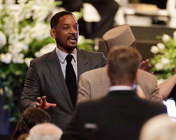 <div class='meta'><div class='origin-logo' data-origin='none'></div><span class='caption-text' data-credit='David Goldman/AP Photo'>Actor Will Smith arrives for Muhammad Ali's memorial service, Friday, June 10, 2016, in Louisville, Ky.</span></div>