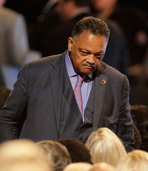 <div class='meta'><div class='origin-logo' data-origin='none'></div><span class='caption-text' data-credit='David Goldman/AP Photo'>Jesse Jackson arrives for Muhammad Ali's memorial service, Friday, June 10, 2016, in Louisville, Ky.</span></div>