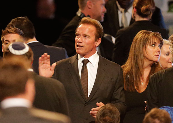 <div class='meta'><div class='origin-logo' data-origin='none'></div><span class='caption-text' data-credit='David Goldman/AP Photo'>Former Governor of California Arnold Schwarzenegger, center, arrives for Muhammad Ali's memorial service, Friday, June 10, 2016, in Louisville, Ky.</span></div>