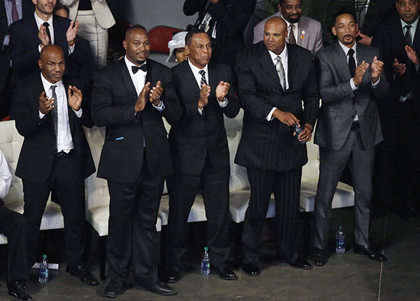 <div class='meta'><div class='origin-logo' data-origin='none'></div><span class='caption-text' data-credit='Darron Cummings/AP Photo'>Pallbearers Mike Tyson, left, Lennox Lewis, second from left, Will Smith, right, and Mike Moorer, second from right, stand during Muhammad Ali's memorial service.</span></div>