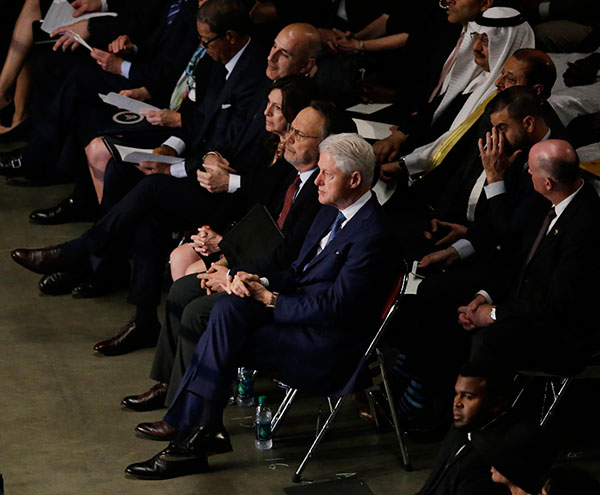 <div class='meta'><div class='origin-logo' data-origin='none'></div><span class='caption-text' data-credit='Darron Cummings/AP Photo'>Former President Bill Clinton sits with comedian Billy Crystal along with other guests during Muhammad Ali's memorial service, Friday, June 10, 2016, in Louisville, Ky.</span></div>