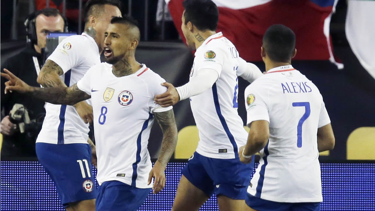 Chile's Arturo Vidal (8) celebrates his goal on a penalty kick during a Copa America Group D soccer match against Bolivia at Gillette Stadium Friday, June 10, 2016, in Foxborough, Mass. Chile won 2-1.