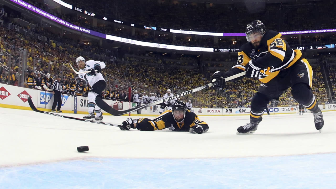 San Jose Sharks' Joe Pavelski scores an empty-net goal in Game 5 of the NHL hockey Stanley Cup Finals on Thursday, June 9, 2016, in Pittsburgh.