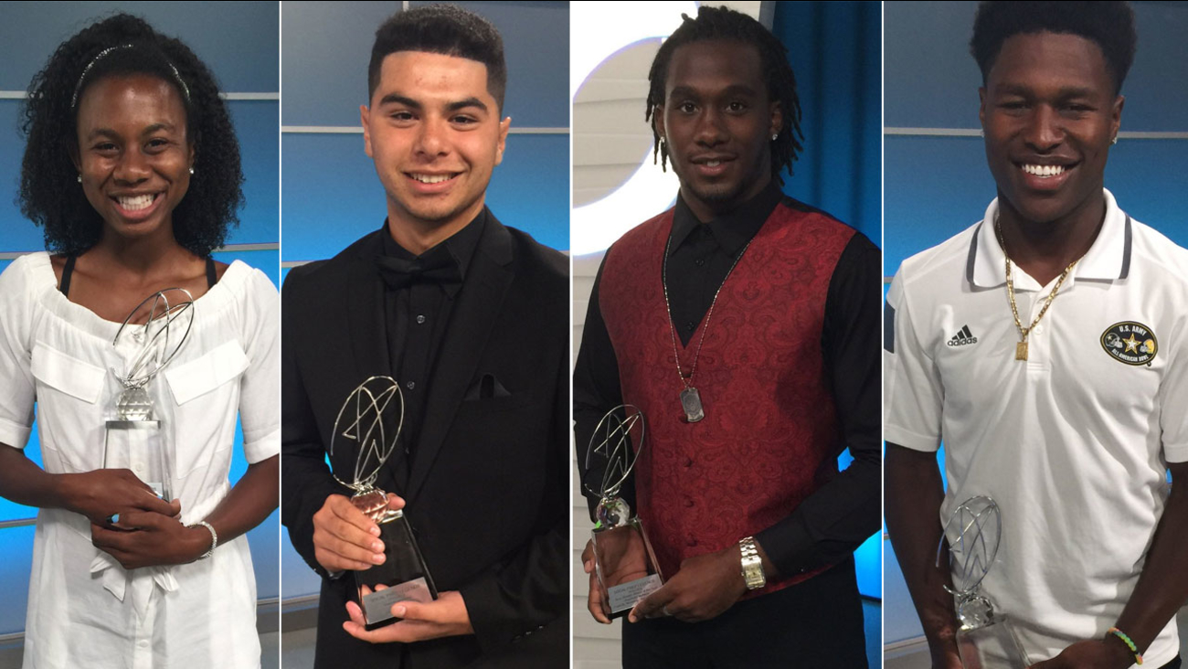 Courtney Corrin, Jacob Beltran, Alexander Mattison and Darney Holmes each hold an award while on the Sports Zone set.