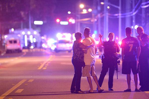 <div class='meta'><div class='origin-logo' data-origin='AP'></div><span class='caption-text' data-credit='AP Photo/Phelan M. Ebenhack'>Orlando Police officers direct family members away from a multiple shooting at a nightclub in Orlando, Fla., Sunday, June 12, 2016.</span></div>