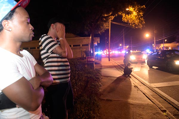 "<div class=""meta image-caption""><div class=""origin-logo origin-image ap""><span>AP</span></div><span class=""caption-text"">Jermaine Towns, left, and Brandon Shuford wait down the street from a multiple shooting at a nightclub in Orlando, Fla. Towns said his brother was in the club at the time. (AP Photo/Phelan M. Ebenhack)</span></div>"