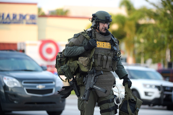 <div class='meta'><div class='origin-logo' data-origin='AP'></div><span class='caption-text' data-credit='AP Photo/Phelan M. Ebenhack'>An Orange County Sheriff's Department SWAT member arrives to the scene of a fatal shooting at Pulse Orlando nightclub in Orlando, Fla., Sunday, June 12, 2016.</span></div>