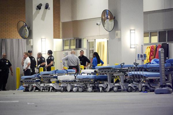 <div class='meta'><div class='origin-logo' data-origin='AP'></div><span class='caption-text' data-credit='AP Photo/Phelan M. Ebenhack'>Emergency personnel wait with stretchers at the emergency entrance to Orlando Regional Medical Center.</span></div>