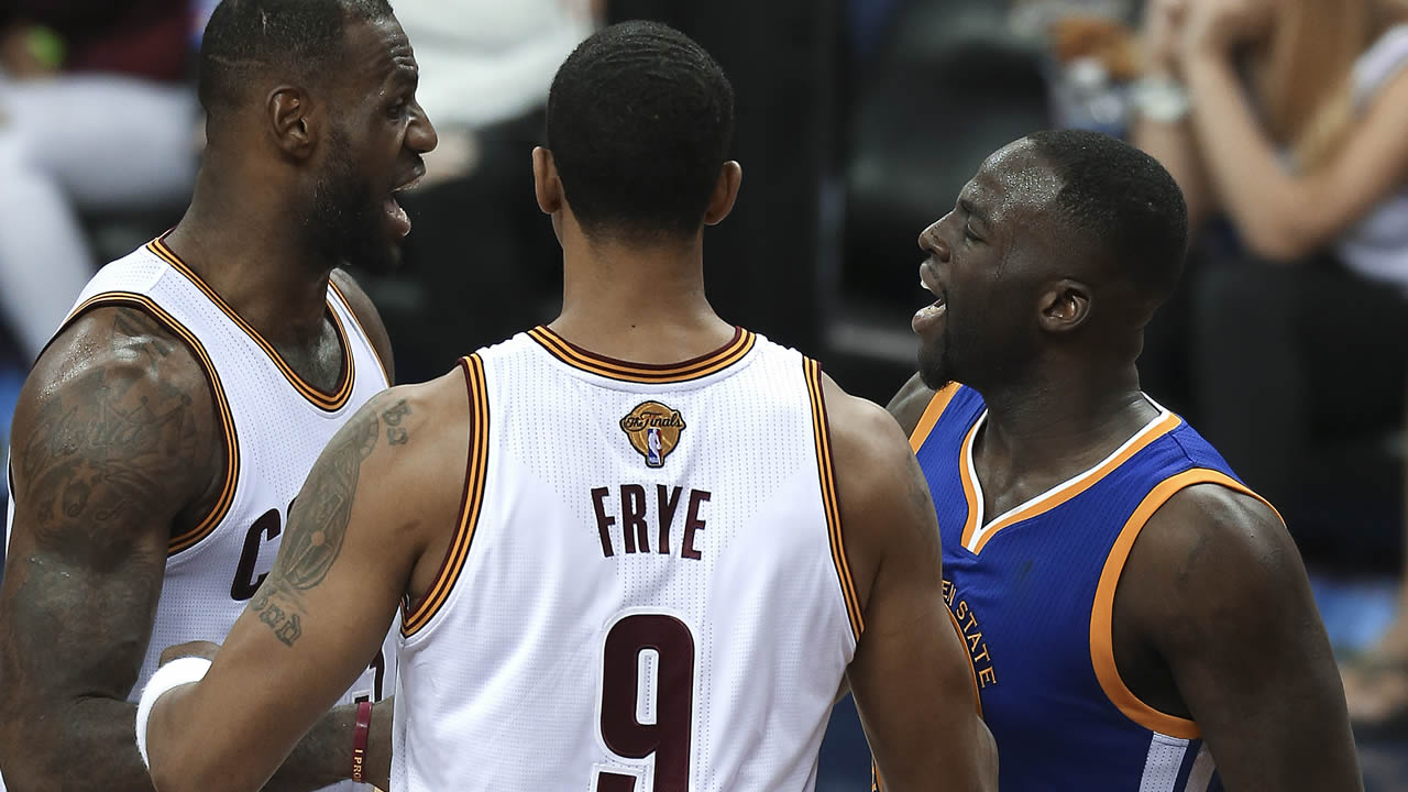 Warriors' Draymond Green and Cavalier' LeBron James argue during Game 4 of basketball's NBA Finals in Cleveland on June 10, 2016.(AP Photo/Ron Schwane)
