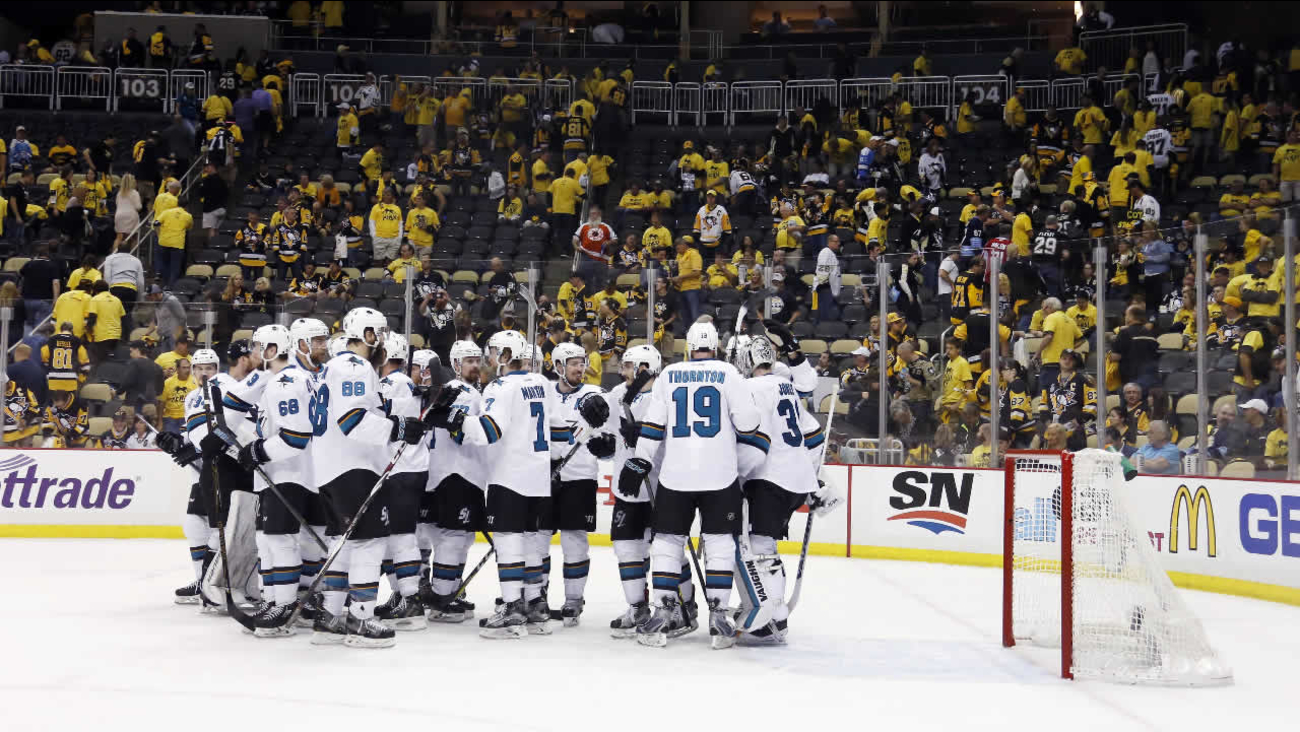 San Jose congratulate San Jose Sharks goalie Martin Jones after their 4-2 win over the Pittsburgh Penguins in Game 5 of the NHL hockey Stanley Cup Finals on Thursday, June 9, 2016, in Pittsburgh.