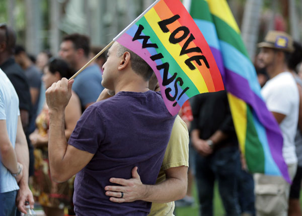 "<div class=""meta image-caption""><div class=""origin-logo origin-image ap""><span>AP</span></div><span class=""caption-text"">Juan Mantilla, 42, of Miami Beach, Fla., left, stands with his partner during a vigil in memory of the victims of the Orlando mass shooting, Sunday, June 12, 2016, in Miami Beach. (AP Photo/Lynne Sladky)</span></div>"